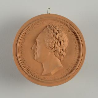 """Circular. head in relief, profile to left. Hair in ringlets. Laurel crown. Circular border inscribed in rellief: """"LOUIS XV PAR LA GRACE DE ROY TRES CHRETIEN MDCCLXX""""."""