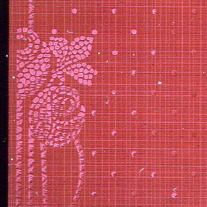 Stylized floral stripe; groups of three roses, in mosaic or stippled design, on spotted background. Printed in light red on deep red plaid background.