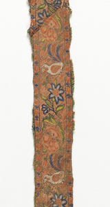 Narrow band showing repeating pattern of flowers and birds.