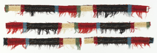 Four fragments from the end of a late Kashmir shawl. Cartouches containing embroidered or tapestry script on backgrounds of black, red or ivory. About 1/4 inch of field pattern intact on some fragments. Other colors include green, light blue, yellow-orange.