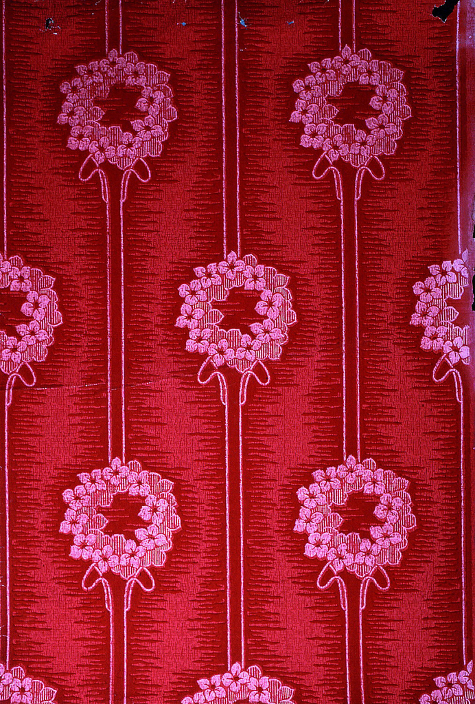 Floral wreaths on stripe. Printed in red on red ground.
