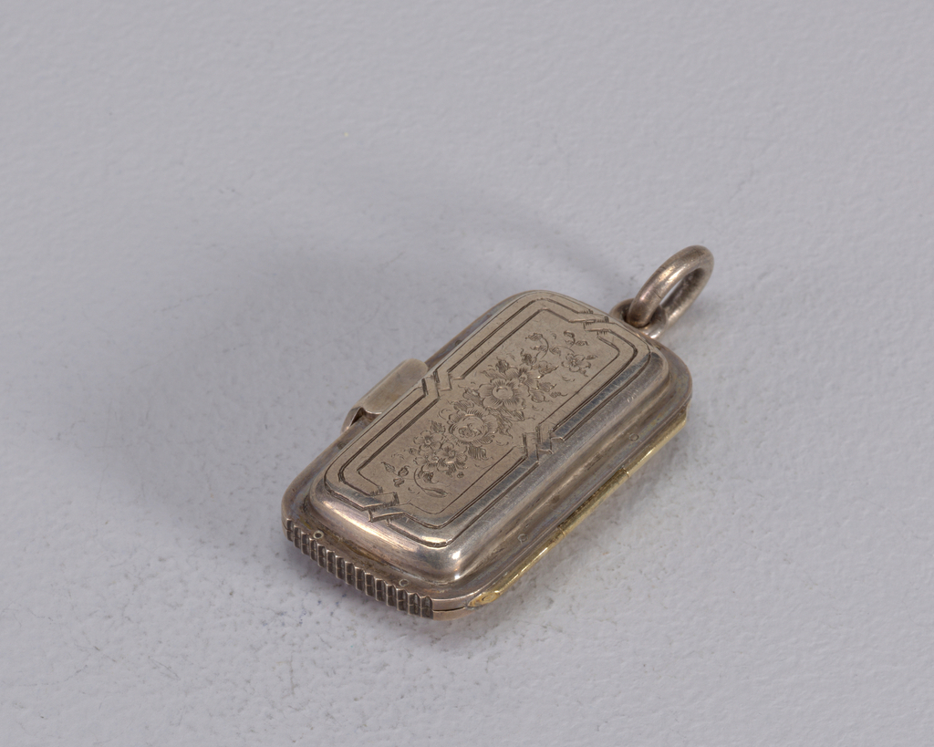 Rectangular, rounded corners, curved sides, featuring polychrome enamel decoration of man on bicycle