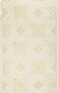 Trellis or grid pattern with framework having beaded chain effect, quatrefoil motif at intersection, and a smaller quatrefoil is centered within each grid. Printed in metallic gold on off-white or tan ground.