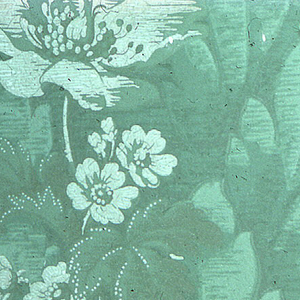 Poppy-like flower, set within dense foliage. Printed in green on green ground.