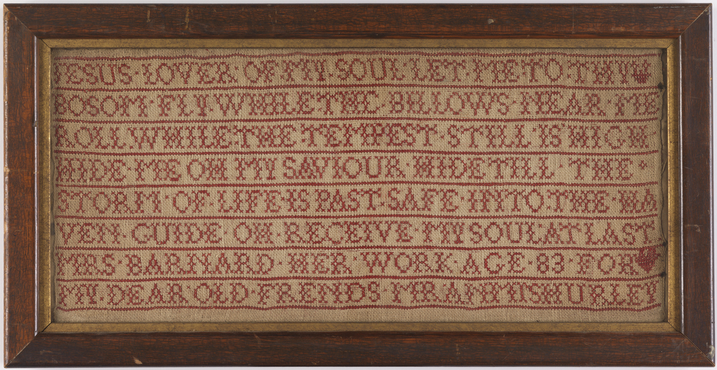 Verse worked in red cross stitch embroidery on natural linen ground.