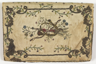 White silk embroidered in floral designs with borders.