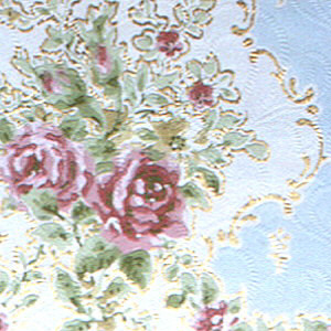 Red roses and floral swags  set within blue niche.