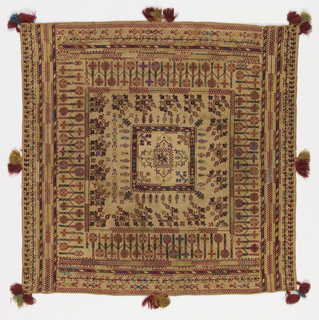 Concentric squared of geometric and stylized floral patterns. Trimmed with tassels on all sides.