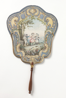 Paper handscreen painted with a scene of four children playing 'blind man's bluff' inside a Rococo cartouche. Mounted on a turned wood handle. Verso: purple flowers painted on a yellow ground.