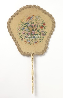 Handscreen with a cream-colored leaf, hand-painted with a basket of flowers and a bird; scrolling trim around edges; turned ivory handle.