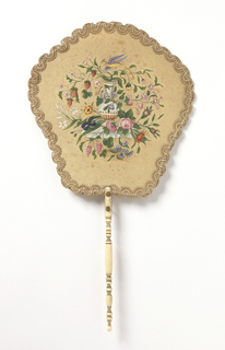 Handscreen with a cream-colored leaf, hand-painted with a basket of flowers with a bird; scrolling trim at edges. Turned ivory handle.
