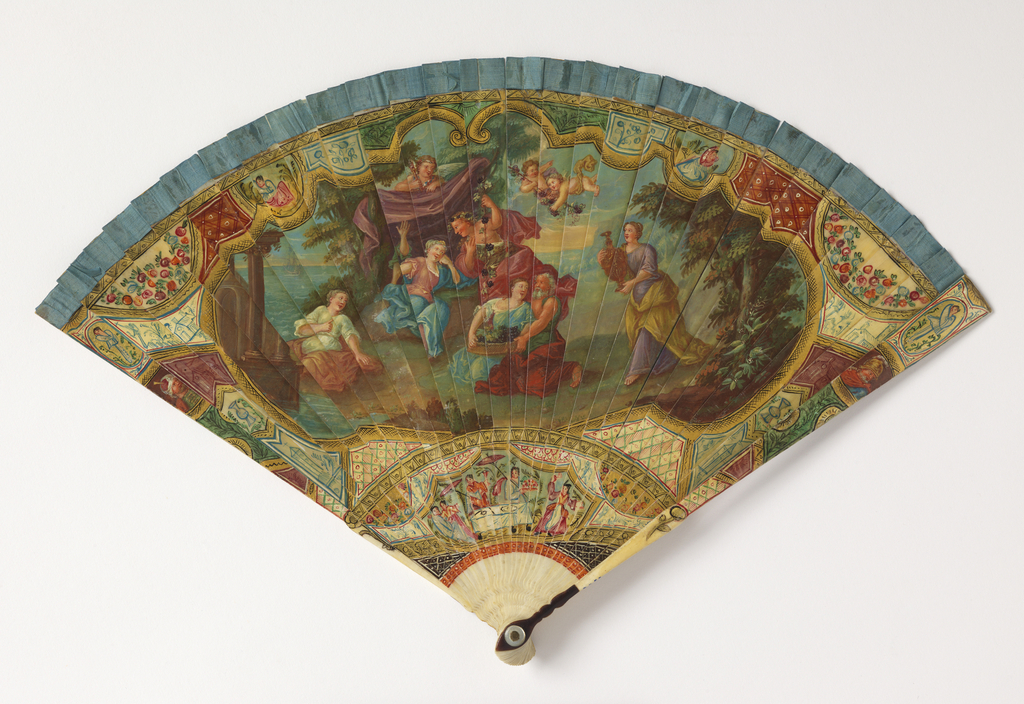 Brisé fan. Ivory sticks, painted gilded and varnished. Obverse: large cartouche enclosing an outdoor scene with figures under a canopy, putti and a woman serving wine. Gorge showing a chinoiserie scene of figures with umbrellas at a table. Reverse: large cartouche enclosing an outdoor scene with two figures by a sea with boats. Tortoiseshell thumb guard; silk connecting ribbon; mother-of-pearl washer at the rivet.